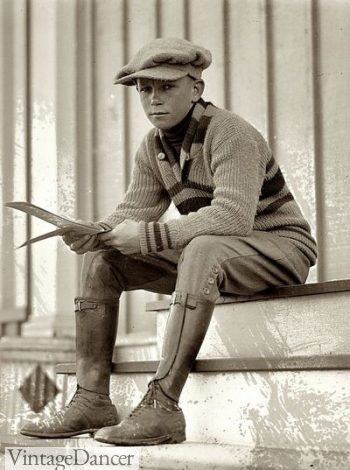 "A 1920s real ""newsboy"" dressed in cap, sweater, knicker pants, leather gaiters and oxford shoes."