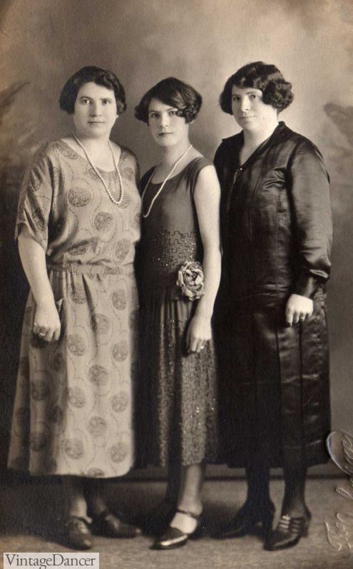 Ladies portrait in afternoon dresses with jewelry.