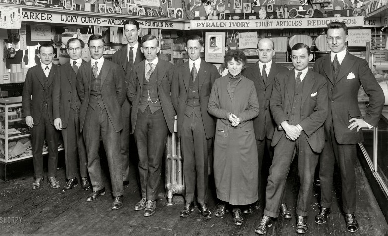 1921, drugstore employees wearing slim fitting post-war suits