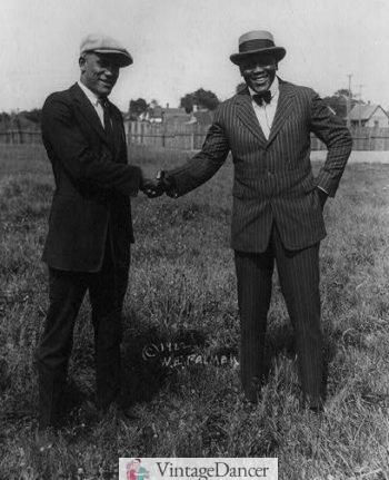 1922 Tut Jackson wearing a striped suit, bow tie and boater hat