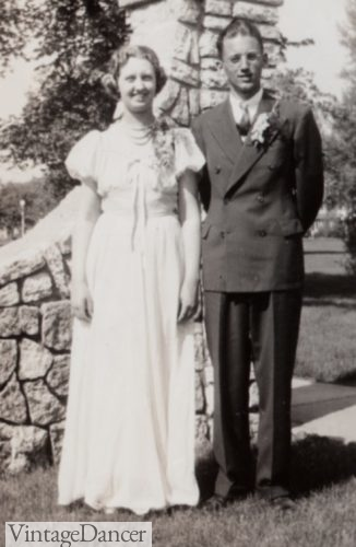 1940s bride- A wedding dress made from silk parachute. Groom is double breasted suit.
