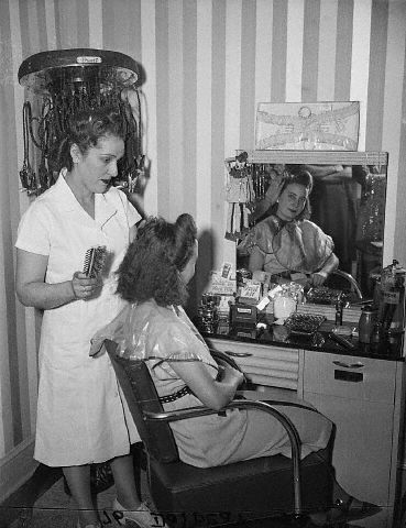 1940s hair salon (permanent wave curl machine in the background)