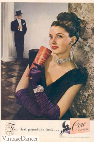 1946 purple evening gloves standout against a black velvet gown