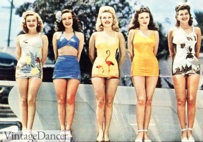 Women lined up wearing 1950s swimsuits in solid and novelty prints. Shop similar styles at VintageDancer