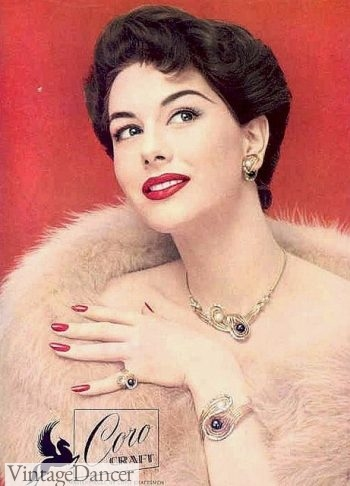 1956, matching set of silver evening jewelry