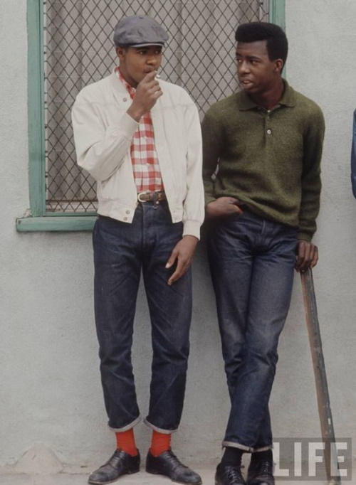 1965 L.A. man on the right wearing a Harrington jacket with plaid shirt, jeans, and cap