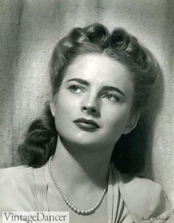 Coleen Gray wearing double Victory rolls on top