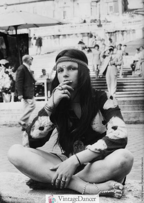 Long hair with a headband was a signature look for hippies in the 60s and 70s