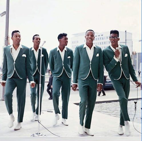 1960s Motown musicians Temptations, green collarless suits with white piping and white boots