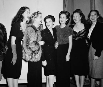 Cocktail party attire for the Christmas broadcast on Oct 30 1944 in Hollywood The group from left includes Virginia O'Brien, Frances Langford, Judy Garland, Dorothy Lamour, Ginny Simms, and Dinah Shore