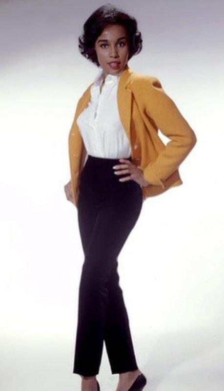 1950s womens fashion pants Diahann Carroll wears cigarette pants, blouse and cardigan