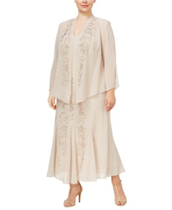 1920s dresses for plus size mature women- A loose jacket layered over a long dress adds vertical lines and covers arms comfortably