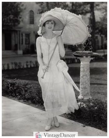 Josephine Dunn 1920s in a white dress with parasol
