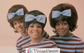 Early 60s Bouffant hairstyle with bow worn by the Marvelettes