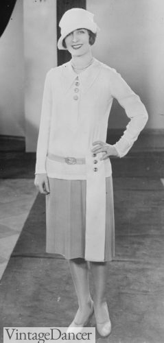1927 Norma Shearer models a two peice white and ?? dress