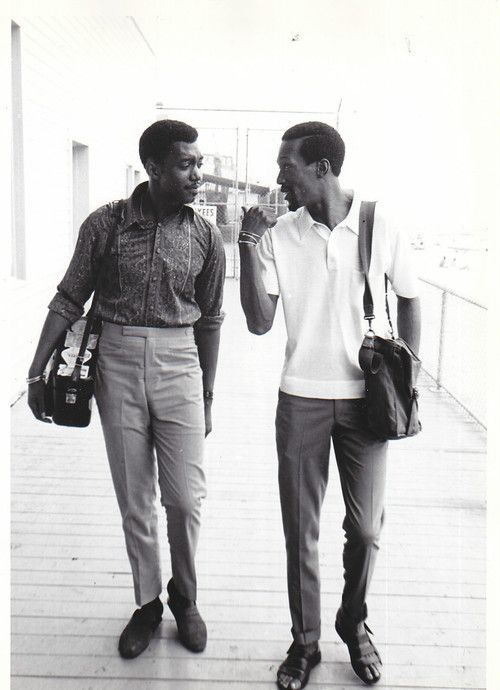 1960s Otis Williams and Eddie Kendricks of The Temptations wear high rise, narrow leg trousers