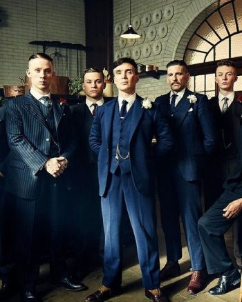 The men of Peaky Blinders sharply dresses is blue striped suits. These would make great men's wedding attire.
