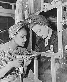 1940s Rosies at work keeping hair tucked away in a turban scarf