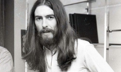 60s mens hairstyles Beatles member George Hairrson with long hair and goatee at VintageDancer