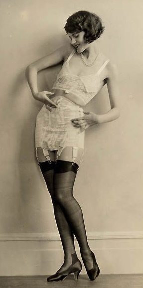 1920s Stockings held up with garter clips attached to a girdle