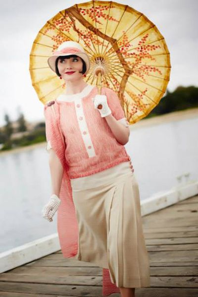Miss Fisher wears a long skirt and peachy blouse as her casual 1920s day fashion
