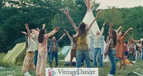 Hippies Performing a Rain Dance in a circle. The hippie women all show various styles acting as precursors to bohemian style.