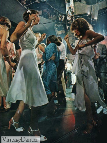 Studio 54 , disco dancing in dresses and jumpsuits