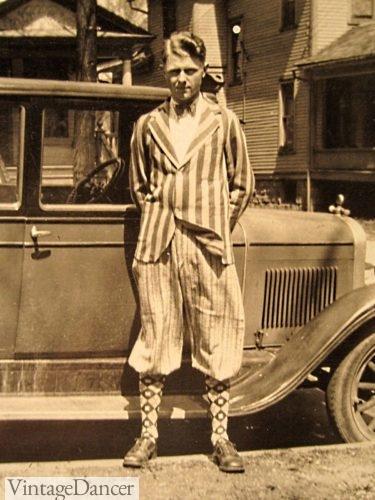 1920s mens funny fashion. clashing patterns! Stripe boater jacket, windowpane knickers, and argyle socks.