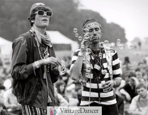 two eccentrically dressed hippie men blowing bubbles in during the 1967 Summer of love at VintageDancer
